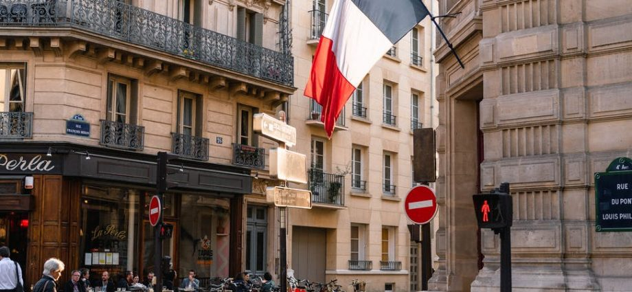 france flag on gray concrete building near road