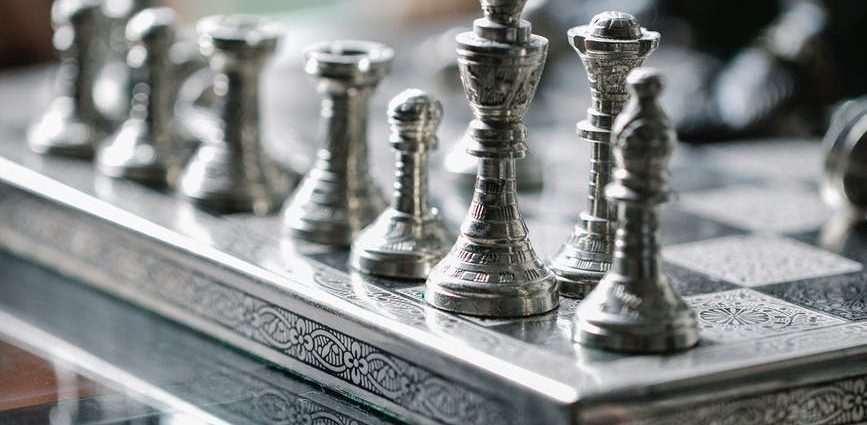 set of chess pieces on board